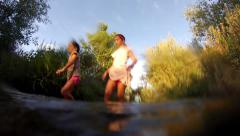 Four Children Walk in Creek Stock Footage