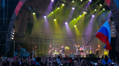 Fans with russian flag at live performance of rock band Bi-2 Stock Footage