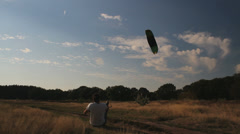 A man is kiting, wideangle - stock footage