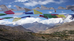 Prayer Flags fluttering high up in the mountains. - stock footage