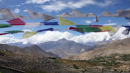 Stock Video Footage of Prayer Flags fluttering high up in the mountains.