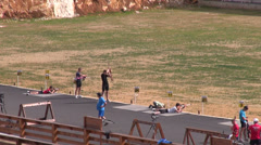 Several biathlonists in the shooting area of a competition, biathlon arena Stock Footage