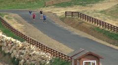 Roller skiing, biathlon summer training, junior team, sports performance Stock Footage