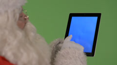 Santa playing with tablet Stock Footage