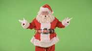 Santa grabs belt and laughs Stock Footage