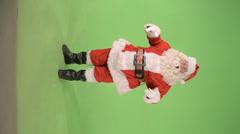 Santa says feliz navidad Stock Footage