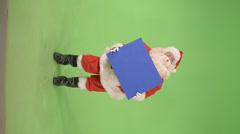 Santa holds a sign side shot Stock Footage