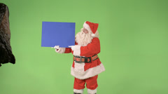 Santa holds a sign middle shot Stock Footage