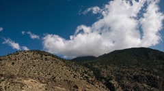 Stock Video Footage of Timelapse of clouds moving around a mountain.
