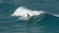 Surfer riding a wave 11097 Stock Footage