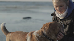 Girl is Playing With Dog at Sea Beach Stock Footage