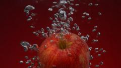 Apple in water, Slow Motion - stock footage