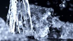 Pouring water on black background, Slow Motion Stock Footage