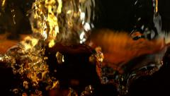 Pouring brown color liquid, Slow Motion Stock Footage