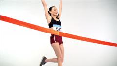 Young female running and crossing the finish line, Slow Motion - stock footage