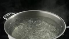 Boiling water in pot, Slow Motion Stock Footage