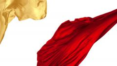 Red and yellow cloth flowing in the air, Slow Motion Stock Footage