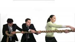 Young business men and woman playing tug-of-war, Slow Motion Stock Footage