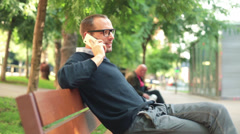 Young man talking on cellphone in the city HD Stock Footage
