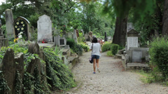 Girl Wandering Among Old Tombstones Stock Footage