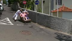 Traditional toboggan ride in Monte, near Funchal, Madeira - stock footage