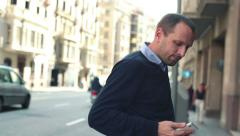 Young impatient man waiting for someone in the city HD Stock Footage