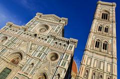 view of duomo cathedral and campanila tower in florence - stock photo