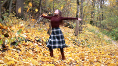 Young woman in beautiful autumn park Stock Footage