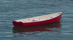 Red Dinghy at Anchor 1 Stock Footage