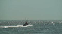 Fishing boat heading out to sea - stock footage