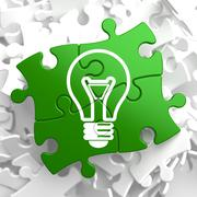 Stock Illustration of Light Bulb Icon on Green Puzzle.