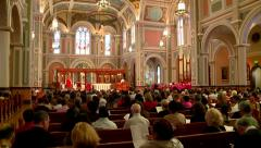 RELIGION RELIGIOUS PEOPLE ATTENDING A MASS AT A CHURCH HD HIGH DEFINITION - stock footage
