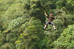 Adult Man Zip Line Adventure In Ecuadorian Rainforest Stock Photos