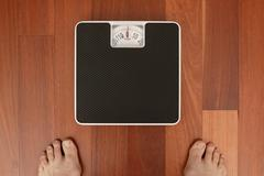 weighing in - stock photo