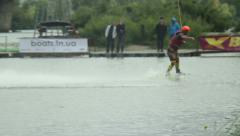 Professional wakeboarder performing tricks summersault tow cable Stock Footage