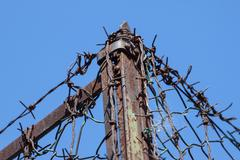 rusty old fences of barb wire - stock photo