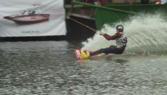 Wakeboarder jumps shows tricks somersaults, water sportsman - stock footage
