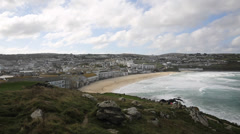 Stock Video Footage of White waves breaking on Cornish beach Porthmeor St Ives Cornwall England