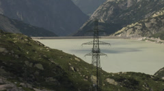 Hydroelectric reservoir. Water dam. Grimsel Lake. Switzerland. Stock Footage