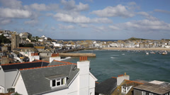 View of St Ives harbour Cornwall England with sea and tide coming in Stock Footage