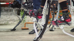 Many jumpers walk on jumping stilts, steel legs for running Stock Footage