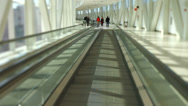 Stock Video Footage of Airport Travelers On Moving Walkway Tilt Shift