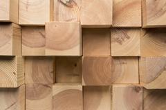 A grid of wooden blocks arranged in varying lengths Stock Photos