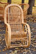 Rocking chair in the back yard. garden and home furniture. Stock Photos