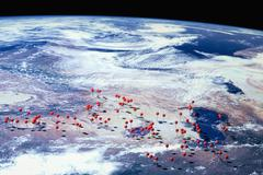 A satellite view of Earth with straight pins at various locations, digital Stock Illustration