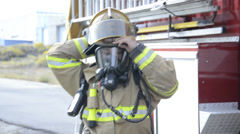 Fireman suiting up Stock Footage