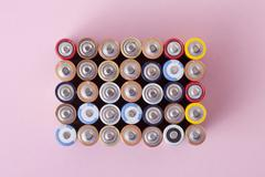 Various colored batteries arranged into a rectangle Stock Photos