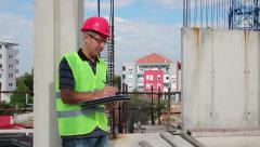 Building Inspector at Construction Site Stock Footage