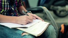 Teenager writing notes in notebook, doing homework HD Stock Footage