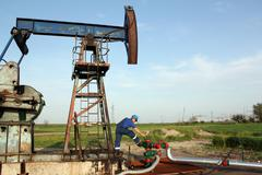 oil worker check pump jack pipeline - stock photo